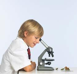 child and microscope - science education