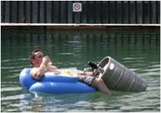 man in flood with keg