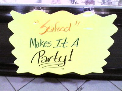 seafood sign with extra quotation marks